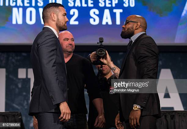 Chris Weidman and Yoel Romero shake hands faceoff during the UFC 205 press event at Madison Square Garden on September 27 2016 in New York City