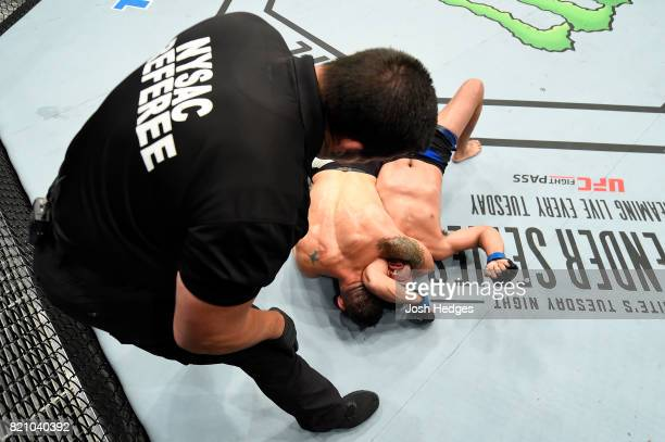 Chris Weidman attempts to submit Kelvin Gastelum in their middleweight bout during the UFC Fight Night event inside the Nassau Veterans Memorial...