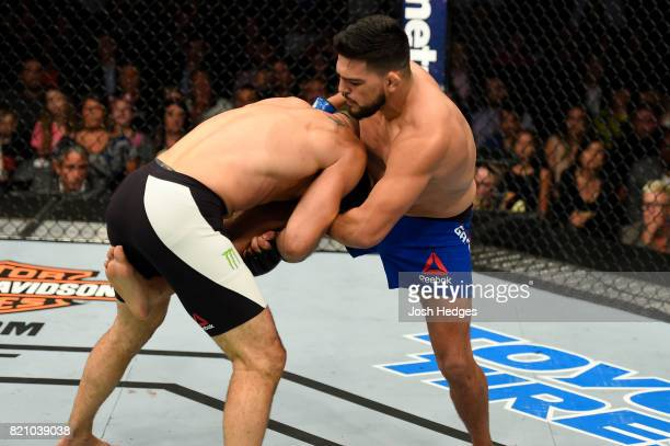 Chris Weidman attempts to takedown Kelvin Gastelum in their middleweight bout during the UFC Fight Night event inside the Nassau Veterans Memorial...