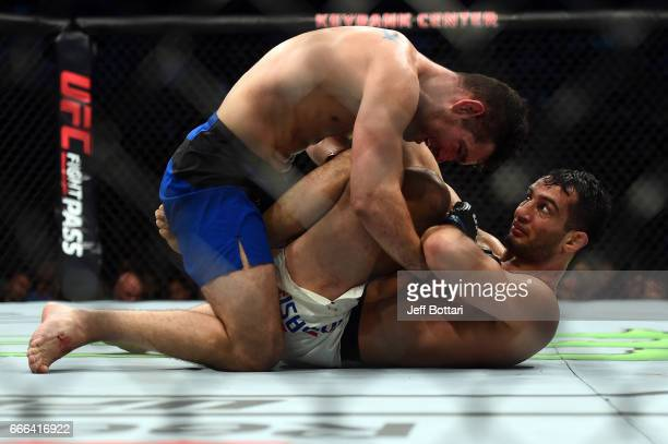 Chris Weidman controls the body of Gegard Mousasi of the Netherlands in their middleweight bout during the UFC 210 event at the KeyBank Center on...