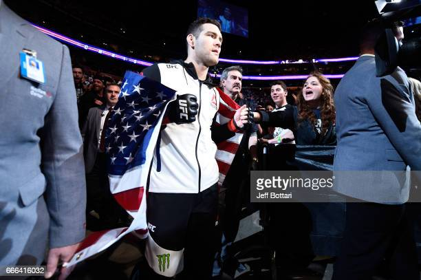 Chris Weidman enters the arena prior to facing Gegard Mousasi of the Netherlands during the UFC 210 event at the KeyBank Center on April 8 2017 in...