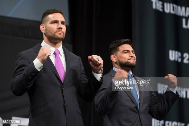Chris Weidman faces off with Kelvin Gastelum during the UFC Summer Kickoff Press Conference at the American Airlines Center on May 12 2017 in Dallas...