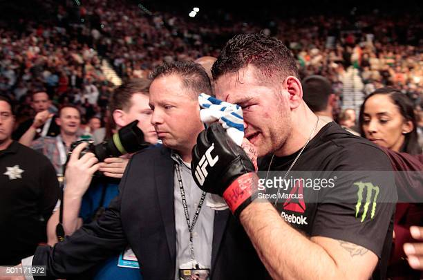 Chris Weidman leaves the arena after losing to Luke Rockhold in their middleweight title fight during UFC 194 at MGM Grand Garden Arena on December...
