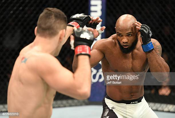 Chris Weidman of the United States fights against Yoel Romero of Cuba in their middleweight bout during the UFC 205 event at Madison Square Garden on...