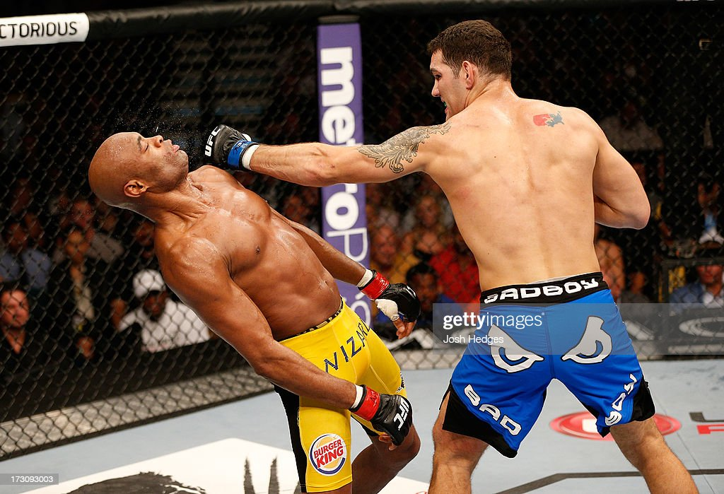 Chris Weidman punches Anderson Silva in their UFC middleweight championship fight during the UFC 162 event inside the MGM Grand Garden Arena on July 6, 2013 in Las Vegas, Nevada.
