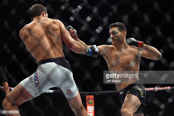 Chris Weidman punches Luke Rockhold in their middleweight championship bout during the UFC 194 event inside MGM Grand Garden Arena on December 12...