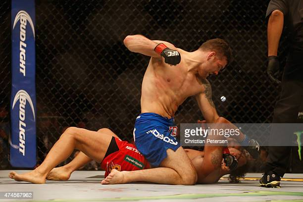 Chris Weidman punches Vitor Belfort of Brazil in their UFC middleweight championship bout during the UFC 187 event at the MGM Grand Garden Arena on...