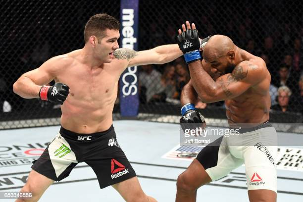 Chris Weidman punches Yoel Romero in their middleweight fight during the UFC 205 event at Madison Square Garden on November 12 2016 in New York City