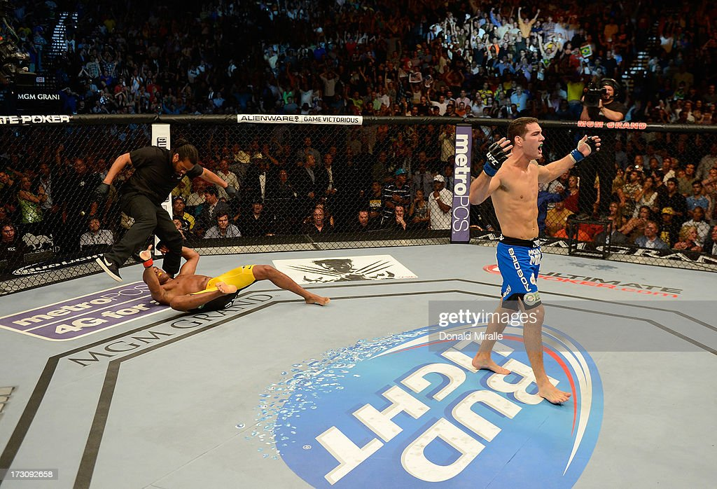 Chris Weidman (R) reacts to his knockout victory over Anderson Silva in their UFC middleweight championship fight during the UFC 162 event inside the MGM Grand Garden Arena on July 6, 2013 in Las Vegas, Nevada.