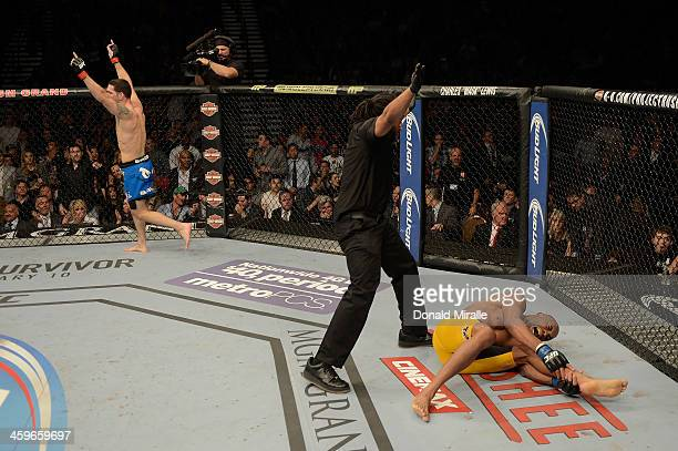 Chris Weidman reacts to his victory over Anderson Silva in their UFC middleweight championship bout during the UFC 168 event at the MGM Grand Garden...