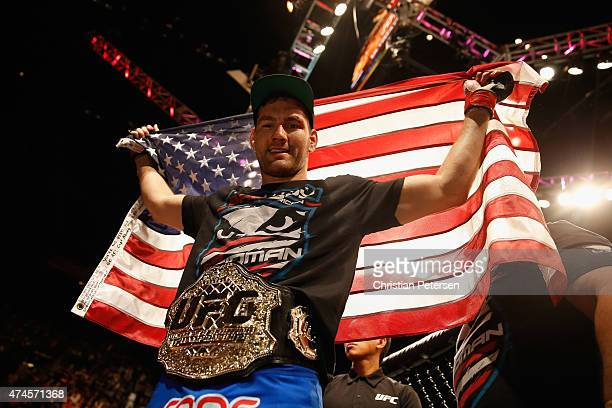 Chris Weidman reacts to his victory over Vitor Belfort of Brazil in their UFC middleweight championship bout during the UFC 187 event at the MGM...