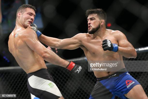 Chris Weidman takes a right hand from Kelvin Gastelum during their UFC Fight Night middleweight bout at the Nassau Veterans Memorial Coliseum on July...