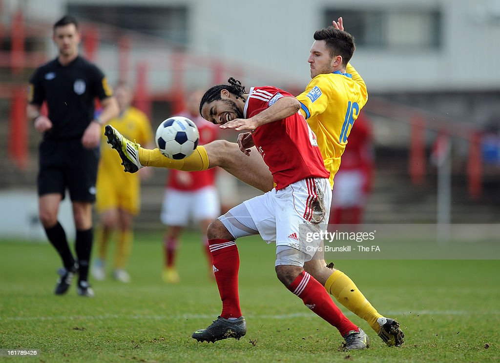 Chris Westwood of Wrexham in action with Bradley Barraclough of Gainsborough Trinity during the FA Trophy Semi-Final match between Wrexham and Gainsborough Trinity at the Racecourse Ground on February 16, 2013 in Wrexham, Wales.
