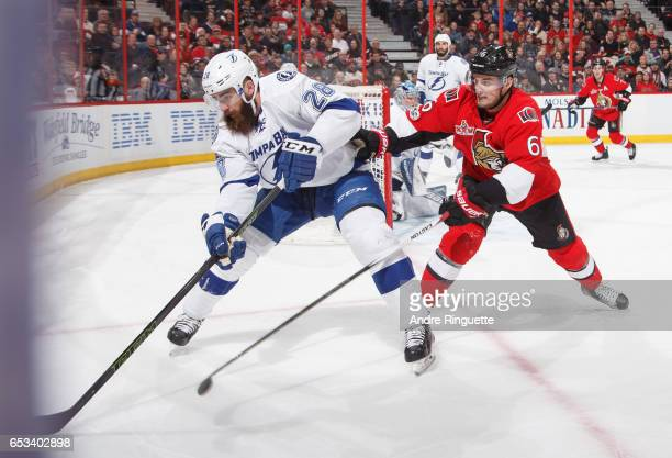 Chris Wideman of the Ottawa Senators battles for puck possession against Luke Witkowski of the Tampa Bay Lightning at Canadian Tire Centre on March...