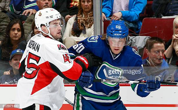 Chris Wideman of the Ottawa Senators checks Markus Granlund of the Vancouver Canucks during their NHL game at Rogers Arena February 25 2016 in...
