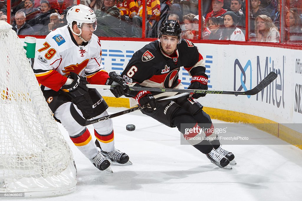 Chris Wideman #6 of the Ottawa Senators clears the puck against Micheal Ferland #79 of the Calgary Flames during an NHL game at Canadian Tire Centre on January 26, 2017 in Ottawa, Ontario, Canada.