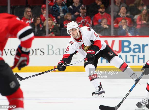 Chris Wideman of the Ottawa Senators passes in an NHL hockey game against the New Jersey Devils at Prudential Center on February 21 2017 in Newark...