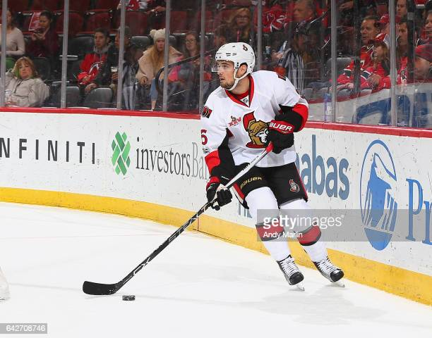 Chris Wideman of the Ottawa Senators plays the puck against the New Jersey Devils during the game at Prudential Center on February 16 2017 in Newark...