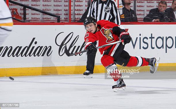 Chris Wideman of the Ottawa Senators shoots the puck against the Buffalo Sabres at Canadian Tire Centre on November 29 2016 in Ottawa Ontario Canada