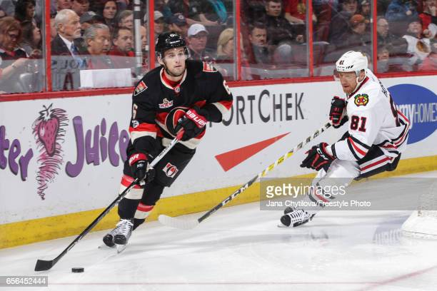 Chris Wideman of the Ottawa Senators skates with the puck against Marian Hossa of the Chicago Blackhawks at Canadian Tire Centre on March 16 2017 in...