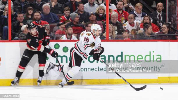 Chris Wideman of the Ottawa Senators uses his stick to slow down Marcus Kruger of the Chicago Blackhawks in the second period at Canadian Tire Centre...