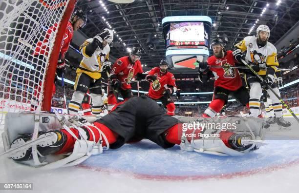 Chris Wideman Tom Pyatt and Fredrik Claesson of the Ottawa Senators defend their net for teammate Craig Anderson agsint Bryan Rust and Nick Bonino of...