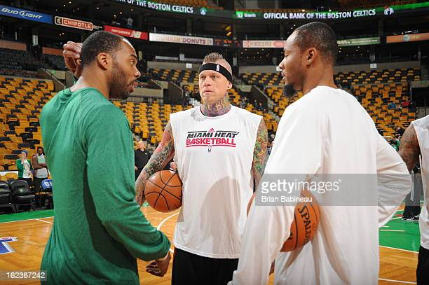 Chris Wilcox of the Boston Celtics and Chris Andersen and Rashard Lewis of the Miami Heat talk before the game on January 27 2013 at the TD Garden in...