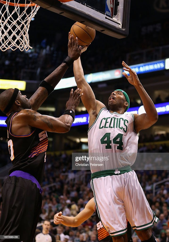 <a gi-track='captionPersonalityLinkClicked' href=/galleries/search?phrase=Chris+Wilcox&family=editorial&specificpeople=202038 ng-click='$event.stopPropagation()'>Chris Wilcox</a> #44 of the Boston Celtics attempts a shot over <a gi-track='captionPersonalityLinkClicked' href=/galleries/search?phrase=Jermaine+O%27Neal&family=editorial&specificpeople=201524 ng-click='$event.stopPropagation()'>Jermaine O'Neal</a> #20 of the Phoenix Suns during the NBA game at US Airways Center on February 22, 2013 in Phoenix, Arizona. The Celtics defeated the Suns 113-88.