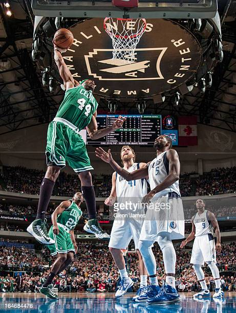 Chris Wilcox of the Boston Celtics dunks the ball against the Dallas Mavericks on March 22 2013 at the American Airlines Center in Dallas Texas NOTE...
