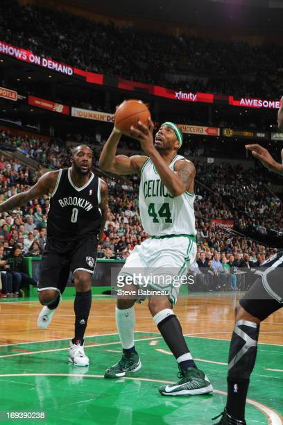 Chris Wilcox of the Boston Celtics goes to the basket against Andray Blatche of the Brooklyn Nets on April 10 2013 at the TD Garden in Boston...