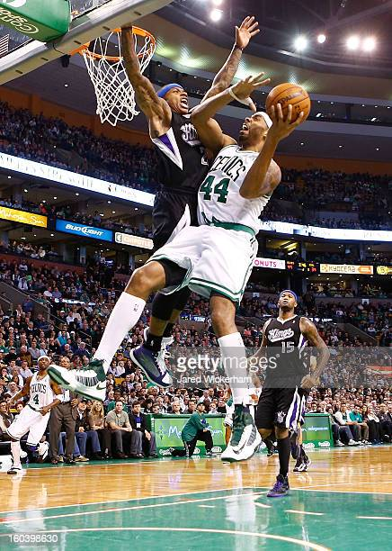 Chris Wilcox of the Boston Celtics goes up for a layup in front of Isaiah Thomas of the Sacramento Kings during the game on January 30 2013 at TD...