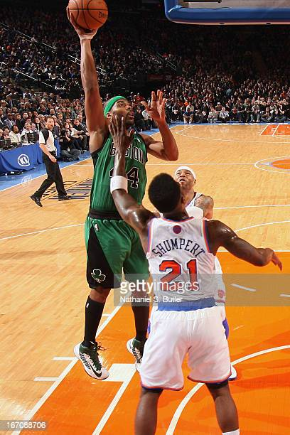 Chris Wilcox of the Boston Celtics goes up for the shot against Iman Shumpert of the New York Knicks on March 31 2013 at Madison Square Garden in New...