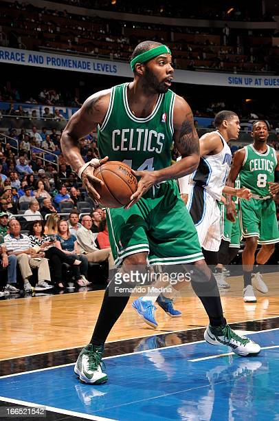Chris Wilcox of the Boston Celtics grabs the rebound and pushes the ball up the floor against the Orlando Magic during the game on April 13 2013 at...