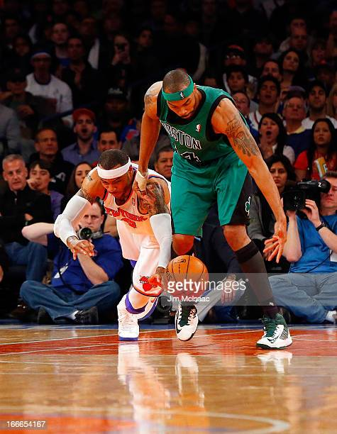 Chris Wilcox of the Boston Celtics in action against Kenyon Martin of the New York Knicks at Madison Square Garden on March 31 2013 in New York City...