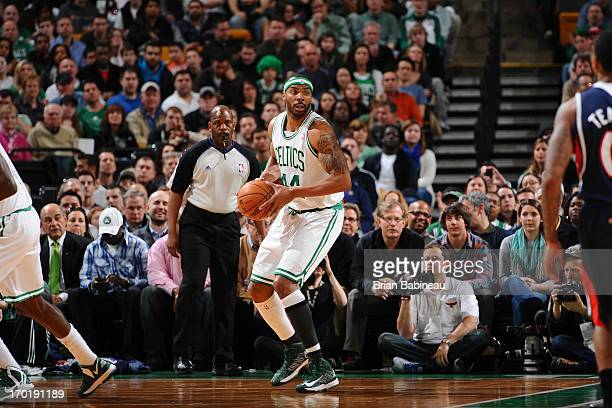Chris Wilcox of the Boston Celtics looks to pass the ball against the Atlanta Hawks on March 29 2013 at the TD Garden in Boston Massachusetts NOTE TO...