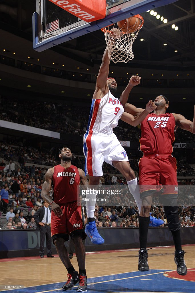 Chris Wilcox #9 of the Detroit Pistons dunks against Erick Dampier #25 of the Miami Heat on March 23, 2011 at The Palace of Auburn Hills in Auburn Hills, Michigan.