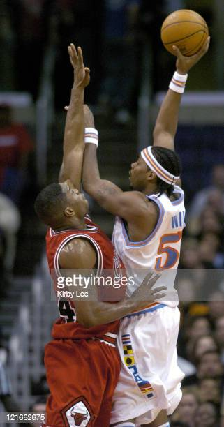 Chris Wilcox of the Los Angeles Clippers is defended by Antonio Davis of the Chicago Bulls during the game between the Los Angeles Clippers and the...