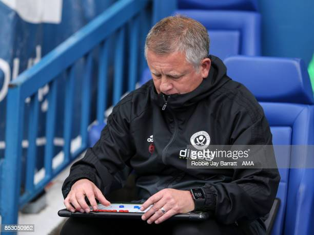 Chris Wilder head coach / manager of Sheffield United looks at his tactics board during the Sky Bet Championship match between Sheffield Wednesday...