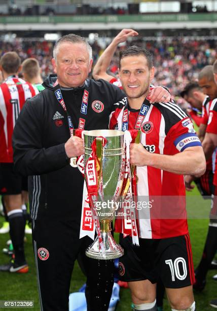 Chris Wilder Sheffield United manager and Billy Sharp Captain of Sheffield United celebrate as they win promotion into next seasons Sky Bet...