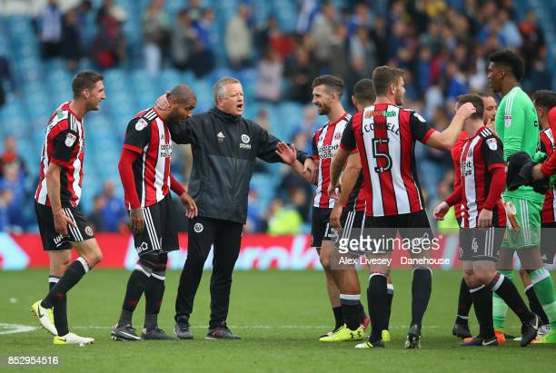 Chris Wilder the manager of Sheffield United celebrates with his players after the Sky Bet Championship match between Sheffield Wednesday and...