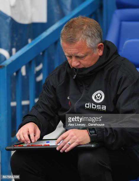 Chris Wilder the manager of Sheffield United looks at his tactics board during the Sky Bet Championship match between Sheffield Wednesday and...