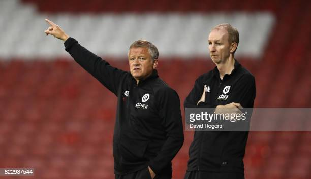 Chris Wilder the Sheffield United manager shouts instructions watched by his assistant Alan Knill during the pre season friendly match between...