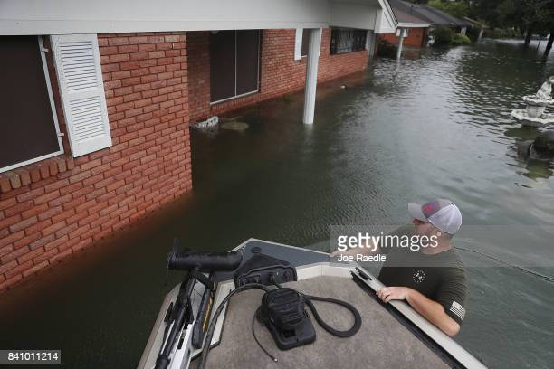 Chris Wiley keeps an eye out for people needing help after the flooding of Hurricane Harvey inundated the area on August 30 2017 in Port Arthur Texas...