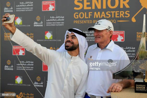 Chris Williams of South Africa poses for a selfie with a local after the final round of the Sharjah Senior Golf Masters played at Sharjah Golf...