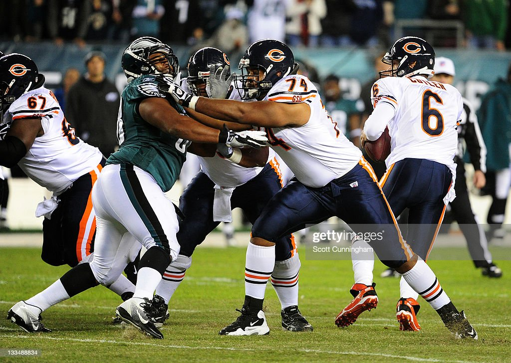 Chris Williams of the Chicago Bears blocks against Mike Patterson of the Philadelphia Eagles at Lincoln Financial Field on November 7 2011 in...