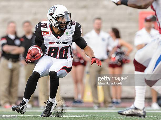 Chris Williams of the Ottawa Redblacks looks to run with the ball during the CFL game against the Montreal Alouettes at Percival Molson Stadium on...