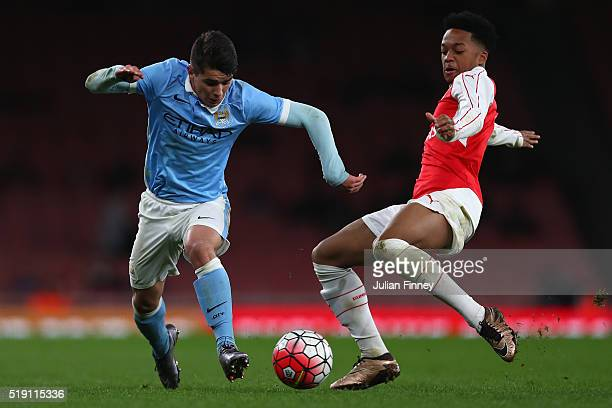 Chris Willock of Arsenal holds off Brahim Diaz of Man City during the FA Youth Cup semifinal second leg match between Arsenal and Manchester City at...