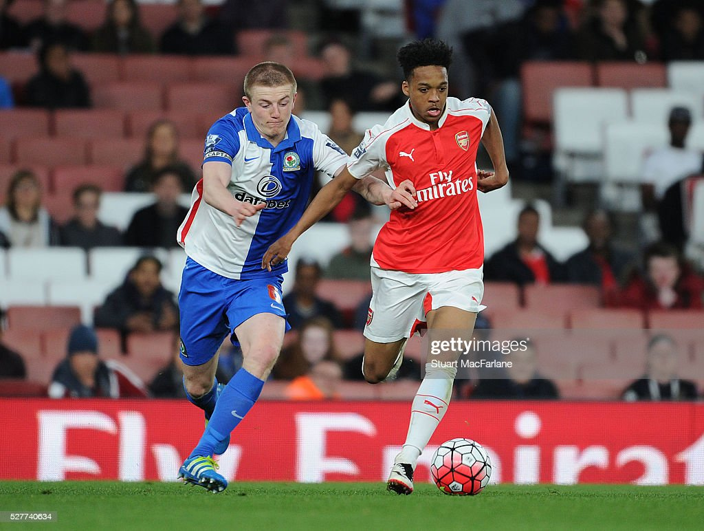 Chris Willock of Arsenal holds off Scott Wharton of Blackburn during the Barclays U21 Premier League match between Arsenal and Blackburn Rovers at Emirates Stadium on May 3, 2016 in London, England.