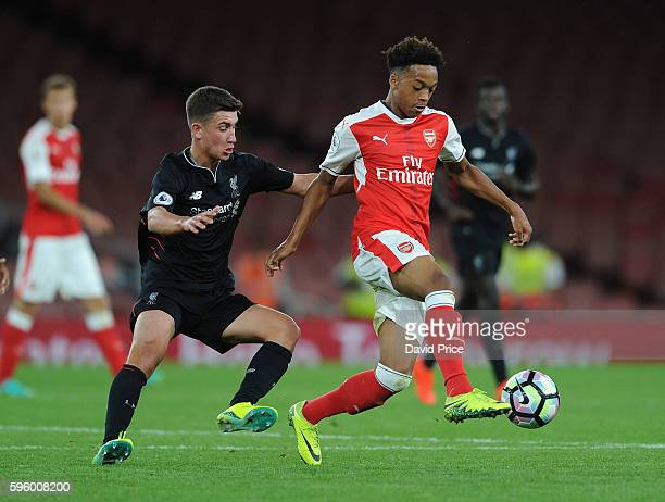 Chris Willock of Arsenal is challenged by Cameron Brannagan of Liverpool during the match between Arsenal U23 and Liverpool U23 at Emirates Stadium...
