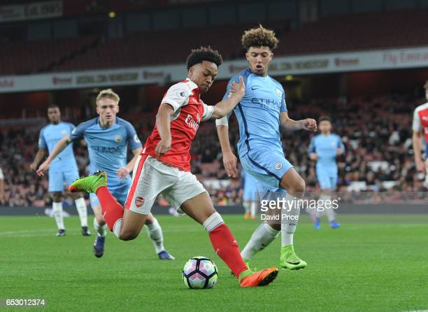 Chris Willock of Arsenal takes on Jadon Sancho of Man City during match between Arsenal and Manchester City at Emirates Stadium on March 13 2017 in...